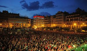 San Fermin revelers at Pamplona's Plaza del Castillo watch a live broadcast of the World Cup soccer final, which is being played in South Africa, after Spain's defeated the Netherlands 1-0 on Sunday, July 11, 2010