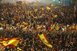 Spanish fans celebrate Spain's Andres Iniesta's goal as they watch a live broadcast at Recoletos' boulevard of the  World Cup soccer final against the Netherlands, which is being played in South Africa, in Madrid on Sunday, July 11, 2010