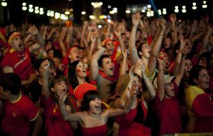 Spanish fans celebrate the goal as they watch in Barcelona's Plaza Espana a live broadcast of the World Cup soccer final between Spain and the Netherlands, which is being played in South Africa, on Sunday, July 11, 2010