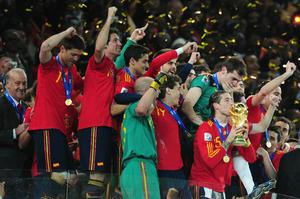 Sergio Ramos of Spain kisses the World Cup trophy as the Spain team celebrate victory following the 2010 FIFA World Cup South Africa Final match between Netherlands and Spain at Soccer City Stadium on July 11, 2010 in Johannesburg, South Africa