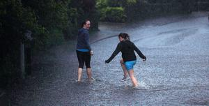 27.06.12. PICTURE BY DAVID FITZGERALDFlooding in Trossachs Drive, Belfast last night. Runners out jogging get caught in the floods
