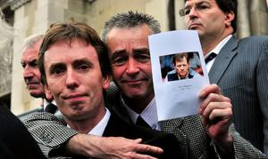 Ken Doherty with fans pay their respects at Alex Higgins funeral