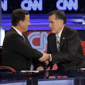 Rick Santorum, left, and Mitt Romney at a Republican presidential debate in Mesa, Arizona (AP/Jae C Hong)