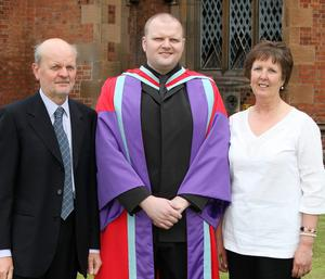 Graduations at Queen's University in Belfast.  Ben Harrison(centre) from Belfast who graduated with a PHD in Electronical and Electronic Engineering pictured with his father David and mother Yvonne.