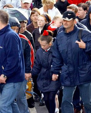 "Paulette Donnelly with her parents arriving at Holy Cross Girls primary School after walking through ""Corridor of Hate"" on Friday (7/9/01)."