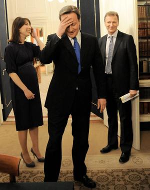 New Prime Minister David Cameron and his wife Samantha meet Cabinet Secretary Gus O'Donnell in the Cabinet Room of 10 Downing Street, London, after an audience with The Queen at which she invited him to form a new government