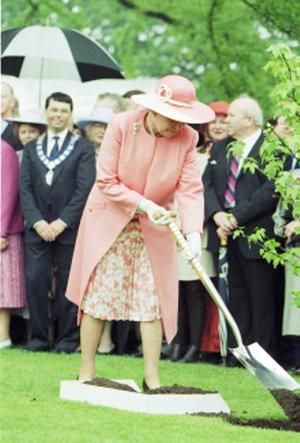 The Queen, Elizabeth 11. 1997 visit.The Queen turns her practised hand to tree planting at Hillsborough Castle.  11/6/1997