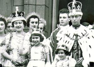 King George V1 (VI) : Coronation on May 12th 1937. The Royal family robed and crowned on the balacony of Buckingham Palace after the coronation, with the princesses.