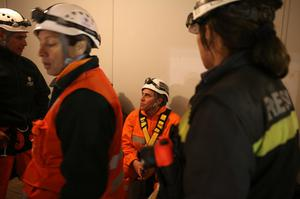 SAN JOSE MINE, CHILE - OCTOBER 12: (NO SALES, NO ARCHIVE) In this handout from the Chilean government, Manuel Gonzalez, a rescue specialist from Codelco, prepares to be the first rescuer lowered into the mine in the unmanned rescue capsule October 12, 2010 at the San Jose mine near Copiapo, Chile. The rescue operation could begin bringing up the 33 miners tonight, 69 days after the August 5th collapse that trapped them half a mile underground. (Photo by Hugo Infante/Chilean Government via Getty Images)