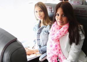 L'VIV, UKRAINE - JUNE 09: Cathy Fischer (L), girlfriend of Mats Hummels and Jenny, girlfriend of Marcel Schmelzer are pictured on the flight from Gdansk to Lviv on June 9, 2012 in L'viv, Ukraine.  (Photo by Joern Pollex/Getty Images)