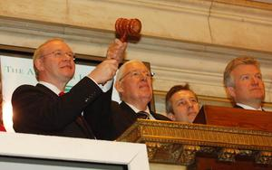 03-12-2007: Northern Ireland Deputy First Minister Martin McGuinness (left) and First Minister Ian Paisley with the hammer at the podium during a visit to the New York Stock Exchange at Wall Street with Ian Paisley Junior (second right) and Duncan Niederauer, CEO of the New York Stock Exchange