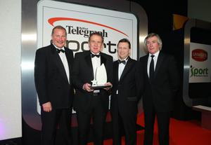 Hall of Fame  - Gerry Armstrong. Gerry Armstrong receives his award from Pat Jennings, Billy Hamilton and John Maguire, Group Managing Director of Belleek
