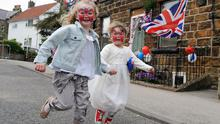 Sadie Lancaster, aged four, (left) and her friend Florence Day, aged five, during a street party held in Castleton, North Yorkshire, to celebrate the royal wedding. PRESS ASSOCIATION Photo. Picture date: Friday April 29, 2011. See PA story WEDDING. Photo credit should read: Anna Gowthorpe/PA Wire