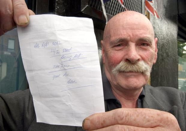 Noel Cairns holds a shopping list given to him by former snooker champion Alex Higgins, near Ulidia House in south Belfast where Higgin's body was discovered.