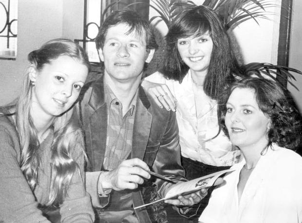 Alex Higgins.  Snooker Legend.  Surrounded by beautiful girls, the lightning Alex. 'Hurricane' Higgins signs autographs for fans Jacqui McFerran, Marion Allen and Catherine McFerran.  (15/04/80)