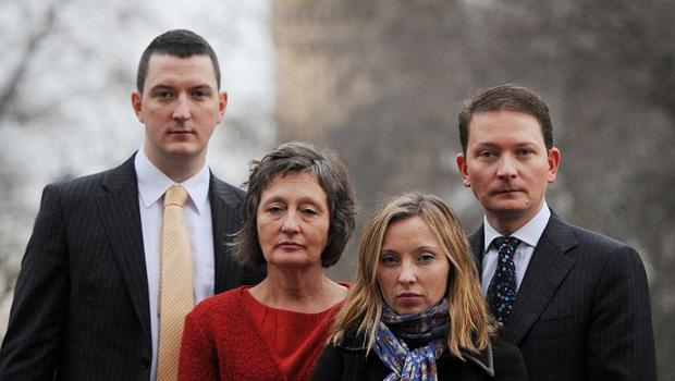 Geraldine Finucane, in red, and her two sons Michael, right, and John Finucane, left, and daughter Katherine in Westminster
