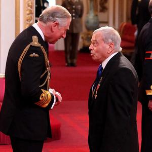 Dickie Bird has described receiving an OBE from the Prince of Wales as an 'honour'
