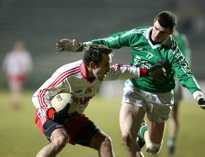 Fermanagh v Tyrone at Brewster Park. Tyrone's Mark Donnelly  with Fermanagh's Michael Jones.
