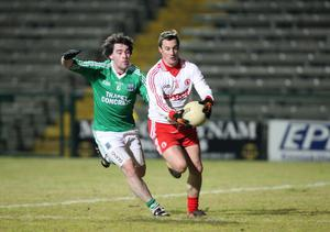 Fermanagh v Tyrone at Brewster Park. Tyrone's Brian McGuigan  with Fermanagh's Barry Mulrone.