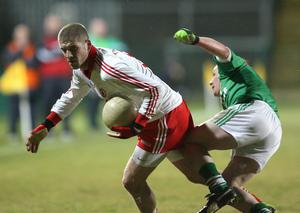 Fermanagh v Tyrone at Brewster Park. Tyrone's Kevin Hughes  with Fermanagh's Niall Cassidy.