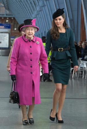 Queen Elizabeth II and Catherine, Duchess of Cambridge (R) arrive at St Pancras station, before boarding a train to visit the city of Leicester, on March 8, 2012 in London, England. The royal visit to Leicester marks the first date of Queen Elizabeth II's Diamond Jubilee tour of the UK between March 8 and July 25, 2012.  (Photo by Anthony Devlin - WPA Pool/Getty Images)