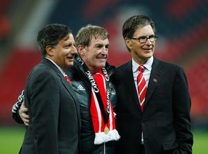LONDON, ENGLAND - FEBRUARY 26:  Kenny Dalglish manager of Liverpool celebrates with Liverpool owners Liverpool owner Tom Werner (L) and John W Henry (R) after victory in the Carling Cup Final match between Liverpool and Cardiff City at Wembley Stadium on February 26, 2012 in London, England. Liverpool won 3-2 on penalties.  (Photo by Paul Gilham/Getty Images)