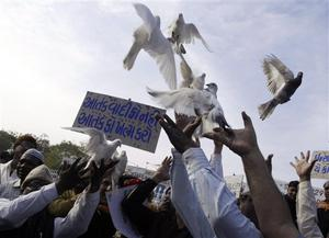 "Indian Muslims, release  pigeons during a protest against terrorist attacks in Mumbai, as a placard reads "" Kill terror not terrorist "" in Ahmadabad, India, Saturday, Nov. 29, 2008. Indian commandos killed the last remaining gunmen holed up at a luxury Mumbai hotel Saturday, ending a 60-hour rampage through India's financial capital by suspected Islamic militants that killed people and rocked the nation. (AP Photo/Ajit Solanki)"