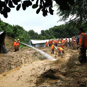 Landslides caused by heavy monsoon rains have killed at least 30 people in southern Bangladesh (AP)