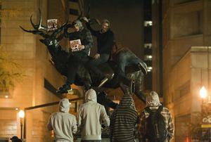 PORTLAND, OR - NOVEMBER 13: Demonstrators mount an elk sculpture as they take part in Occupy Portland November 13, 2011 in Portland, Oregon.  In spite of an eviction notice for early Sunday morning, Portland police delayed closing two downtown parks early today as thousands of people converged to support the Occupy Portland movement.(Photo by Natalie Behring/Getty Images)