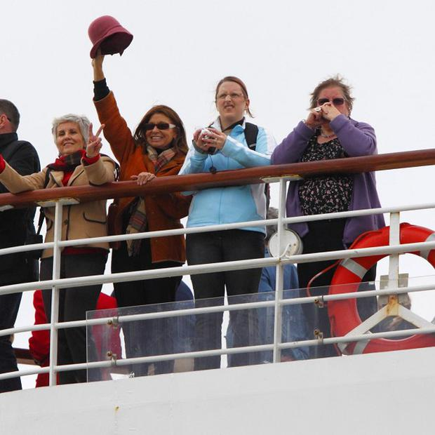 Passengers onboard the Balmoral cruise ship wave as they leave Southampton docks on the Titanic centenary voyage