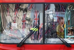 LONDON, ENGLAND - APRIL 19:  Bunting is reflected in a bus window on Regent Street on April 19, 2011 in London, England. Preparations are underway across the city as the Royal wedding of HRH Prince William and Kate Middleton draws nearer.  (Photo by Dan Kitwood/Getty Images)