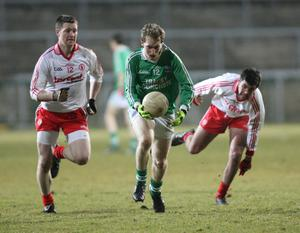 Fermanagh v Tyrone at Brewster Park. Fermanagh's Tommy McElroy gets away from Tyrone's Enda McGinley and Ciaran Girvan.