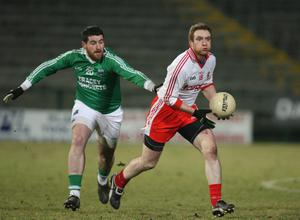 Fermanagh v Tyrone at Brewster Park. Tyrone's Aidan Cassidy  with Fermanagh's Seamus Quigley.