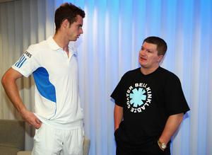Andy Murray of Great Britain chats with boxer Ricky Hatton after Murrary's quarter-final match win against Rafael Nadal of Spain during day nine of the 2010 Australian Open at Melbourne Park