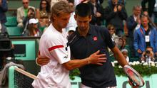 PARIS, FRANCE - JUNE 03:  Novak Djokovic of Serbia is congratulated by Andreas Seppi of Italy after their men's singles fourth round match during day 8 of the French Open at Roland Garros on June 3, 2012 in Paris, France.  (Photo by Clive Brunskill/Getty Images)