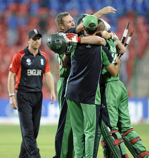 Ireland celebrate winning during the ICC Cricket World Cup match at the at M Chinnaswamy Stadium, Bangalore, India