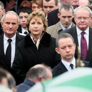Irish President Mary McAleese with husband Martin (left) and deputy First Minister Martin McGuinness (right) at the funeral of Brendan McAleese