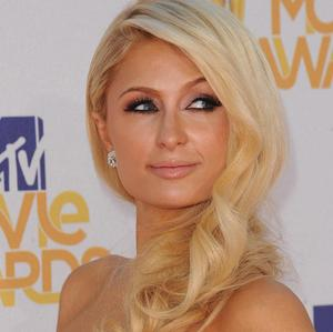 A man has been arrested on suspicion of violating a restraining order that bars him from being within 200 yards of Paris Hilton or her home