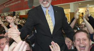 Sinn Fein President Gerry Adams is lifted by supporters after being elected TD in Co Louth
