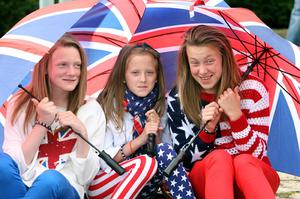 Girls watch the start of the Orange Order parade in Belfast, as the 12th of July celebrations get underway, with Belfast hosting one of the largest parades