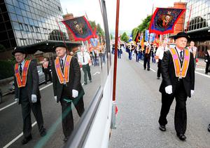 Orange Order men as they parade through Belfast