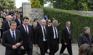 PEDRENA, SPAIN - MAY 11:  (L to R) Chief Executive of The European Tour George O'Grady Nick Faldo of England, Roger Chapman of England, Colin Montgomery of Scotland, Sam Torrance of Scotland and Ian Woosnam of Wales walk following the urn containing the ashes of Seve Ballesteros to attend the ceremony during the funeral service held for the legendary Spanish golferon May 11, 2011 in Pedrena, Spain. Top-ranked golf players have joined family members and friends to pay their last respects to the late golf great, who died on May 7, 2011 from complications arising from a brain tumor, in his home town parish church.  (Photo by David Ramos/Getty Images)