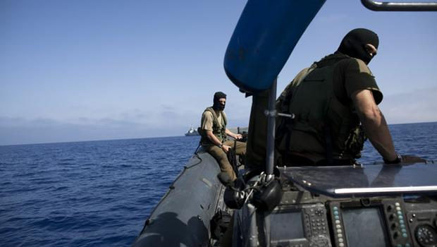 Israeli Navy soldiers aboard a boat as the Israeli Navy intercepts peace boats bound for Gaza on May 31, 2010
