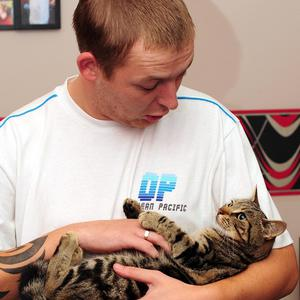 Kitten, Lola, owned by Stephanie and Darryl Mann, is held by it's owner, following her ordeal of being dumped in a bin