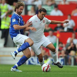 Gerard Butler, left, and Paddy McGuiness during the match at Old Trafford for Soccer Aid