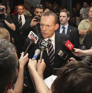Opposition leader Tony Abbott speaks to the media ahead of the general election