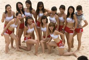 Chinese women pose for photos after a rehearsal to be cheerleaders for the upcoming 2007 FIVB Beach Volleyball Women's Challenger held from Aug 13-19 at the Chaoyang Park Beach Volleyball Ground in Beijing, China