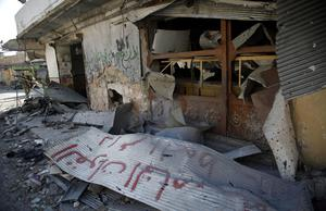 In this Sunday Aug. 5, 2012 photo, destroyed shops are seen in the town of Atareb  on the outskirts of Aleppo, Syria. (AP Photo/Khalil Hamra)