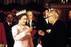13/10/1986 Queen Elizabeth II and President Li Xiannian drinking a toast at a banquet in Beijing. The Queen was the first British Monarch to ever visit mainland China. PRESS ASSOCIATION Photo.