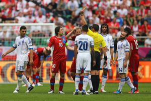 WROCLAW, POLAND - JUNE 12:  Referee Stephane Lannoy shows Tomas Rosicky of Czech Republic a yellow card during the UEFA EURO 2012 group A match between Greece and Czech Republic at The Municipal Stadium on June 12, 2012 in Wroclaw, Poland.  (Photo by Christof Koepsel/Getty Images)